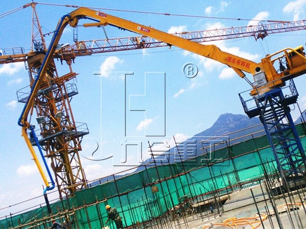 Elevator shaft climbing hydraulic concrete placing boom